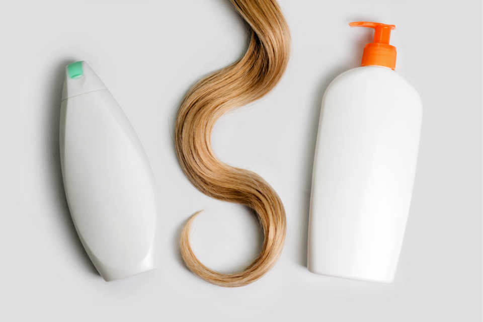 Two bottles of shampoo as a metaphor for finding one business software solution that does two things