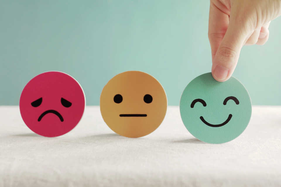 Improve employee experience - person choosing smiling face symbol