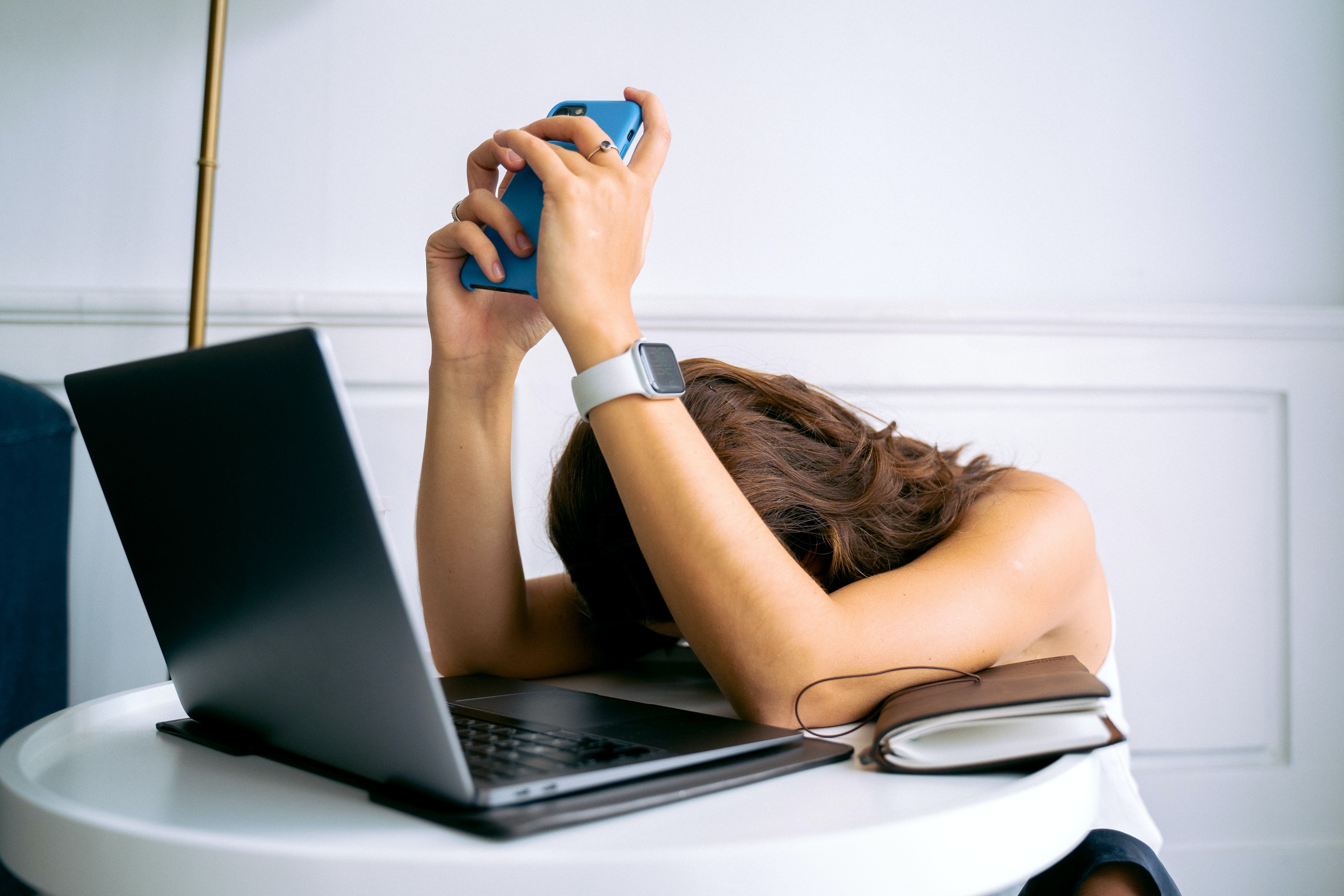 Digital learning fatigue - photo of women looking fed up in front of computer